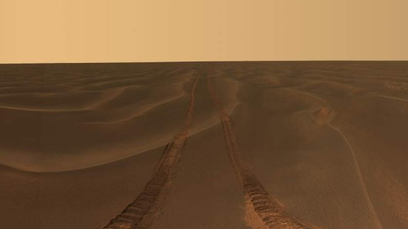 Opportunity photographed its tracks in the soft sand between the Endurance and Victoria craters on the Meridiani Plains.