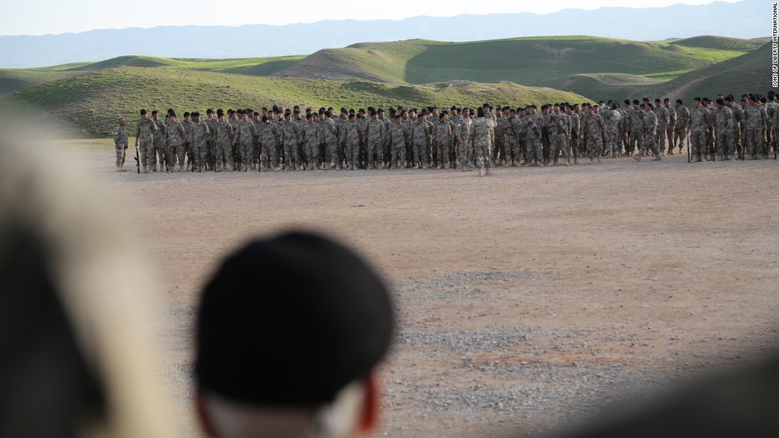 A commander overseas recruits trained by SOLI instructors.