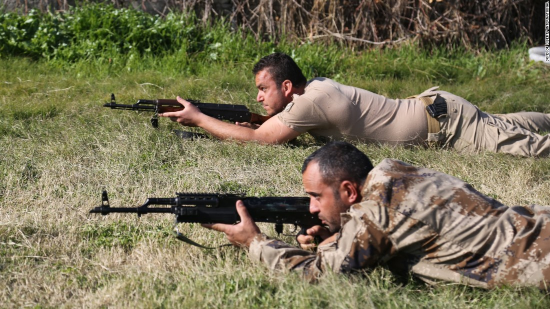 Militia recruits fire from a prone position under the instruction of SOLI trainers.