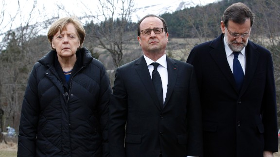 From left, German Chancellor Angela Merkel, French President Francois Hollande and Spanish Prime Minister Mariano Rajoy pay respect to victims at the crash site on March 25.