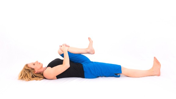 Supine bent-knee twist: Stretches hip, groin and low-back muscles.