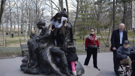 A photo of children climbing on the Vietnam women's memorial prompts complaints.