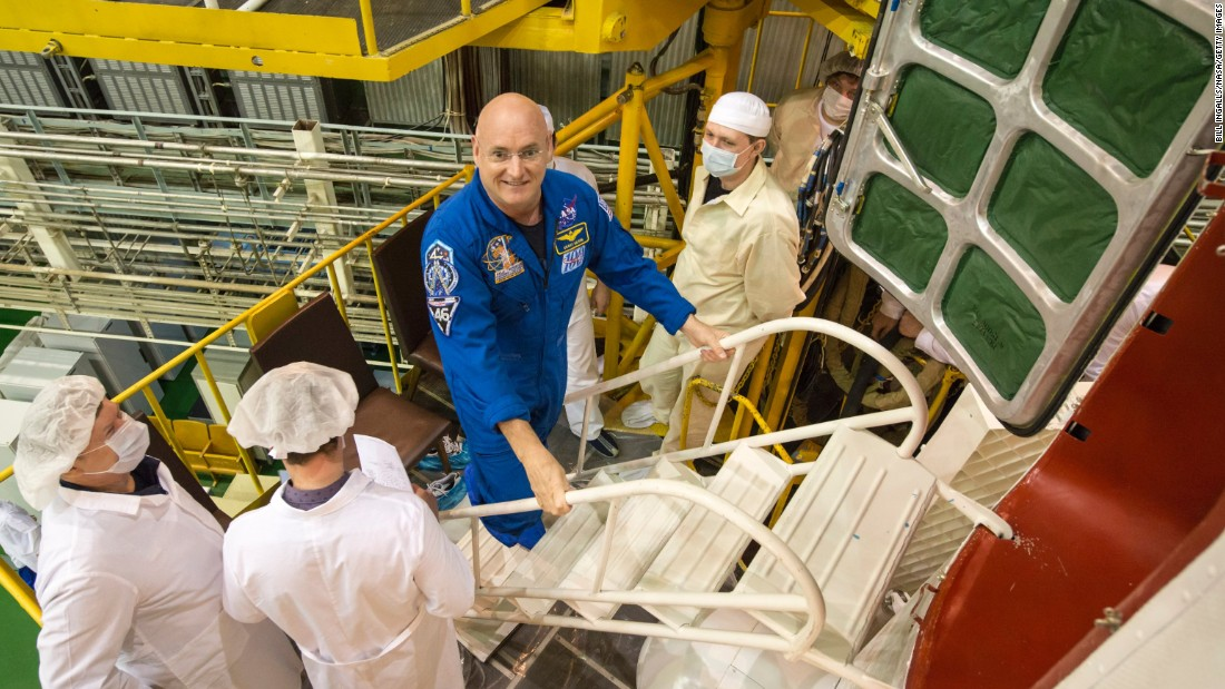 Kelly climbs the stairs to enter the spacecraft during the final check on March 23.