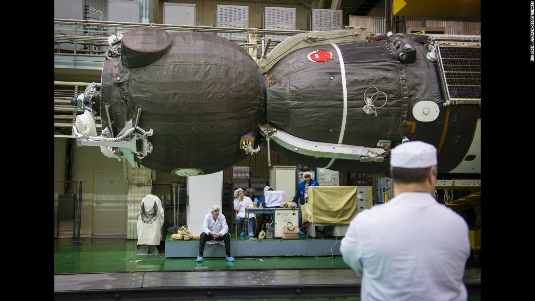 The spacecraft is seen on Friday, March 20, after being lowered into position for encapsulation.