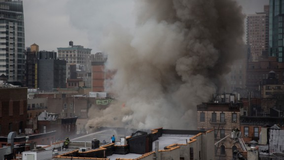 Smoke obscures the New York skyline as firefighters battle the blaze.
