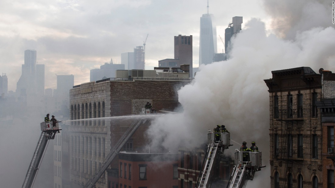 Firefighters work the scene of a burning building after an explosion on March 26 on New York City's Second Avenue.