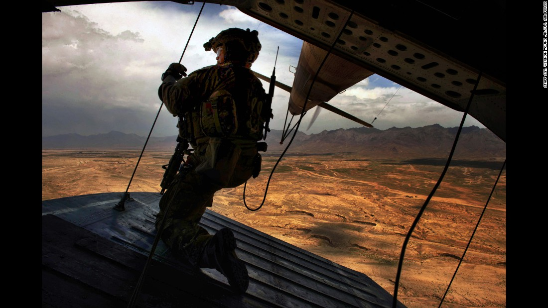U.S. Air Force Tech. Sgt. Josh Martin, an aerial gunner with the 438th Air Expeditionary Advisory Squadron, provides rear security on a Mi-17 helicopter in Kabul, Afghanistan, on May 31, 2014. The squadron and the Afghan air force have combined training efforts to help Afghan helicopter crews work seamlessly in support of ground forces in combat.