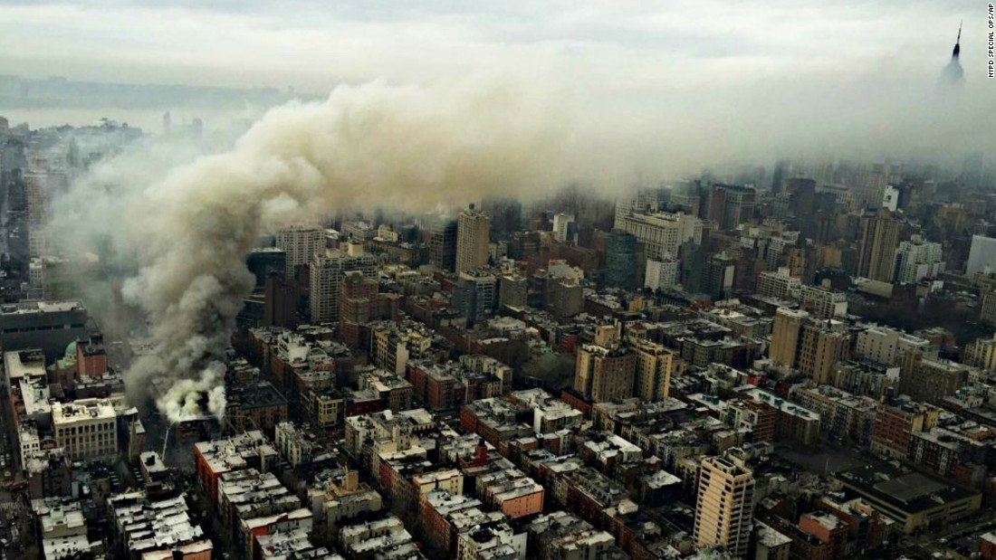 "In this photo provided by the NYPD Special Ops, smoke rises from the scene of a large fire and a partial building collapse in the East Village neighborhood of New York on Thursday, March 26. The seven-alarm fire in Manhattan's East Village drew firefighters from across the city. The blast appeared to be a ""gas-related explosion,"" Mayor Bill de Blasio said."