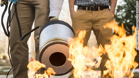 Two engineering students developed a fire extinguisher that works with sound waves. Photo by Evan Cantwell/George Mason University