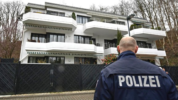 A police officer stands guard March 26 at an apartment building where Lubitz was thought to have lived in Dusseldorf.