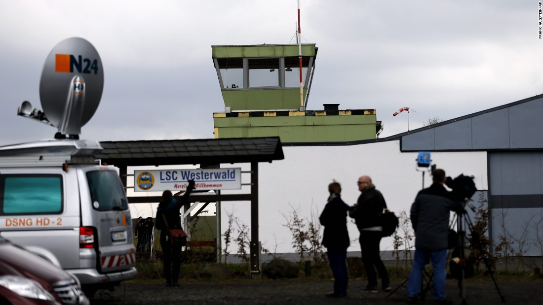 Journalists stand in front of the Westerwald airfield in Montabaur, Germany, on March 27. Lubitz reportedly learned to fly here.