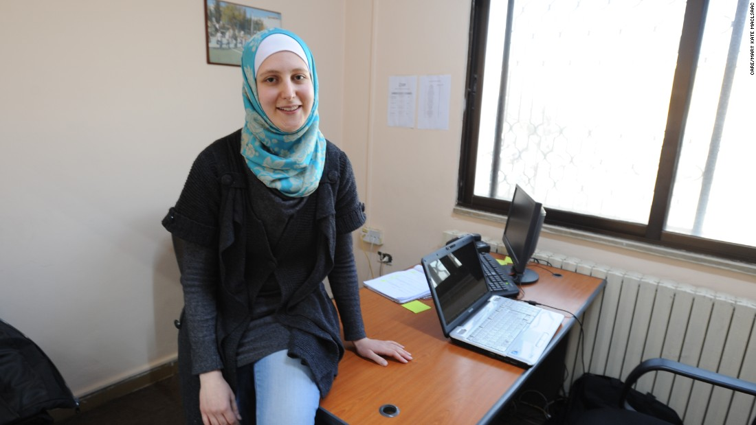"Hiba poses at the CARE urban refugee center where she volunteered.  ""After working there, I have become more social, and no longer feel isolated. It's not like sitting at home, feeling powerless, losing confidence, wondering what I can do to help my family, to help my people.  Instead I feel empowered.  I recognize my potential."""