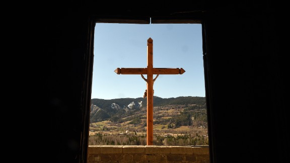 A cross is pictured at Seyne-les-Alpes, France, on March 27, a day after families of crash victims arrived near the plane crash site.