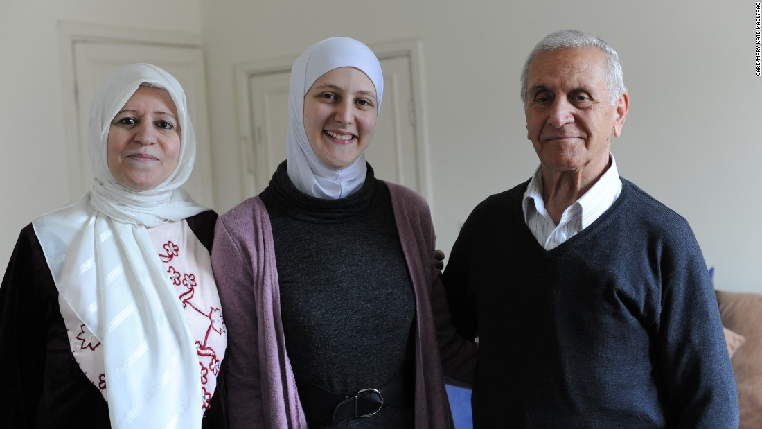 Hiba with her parents Salim and Hanan, in their apartment. Before he retired, Salim was an engineer and Hanan, a teacher.