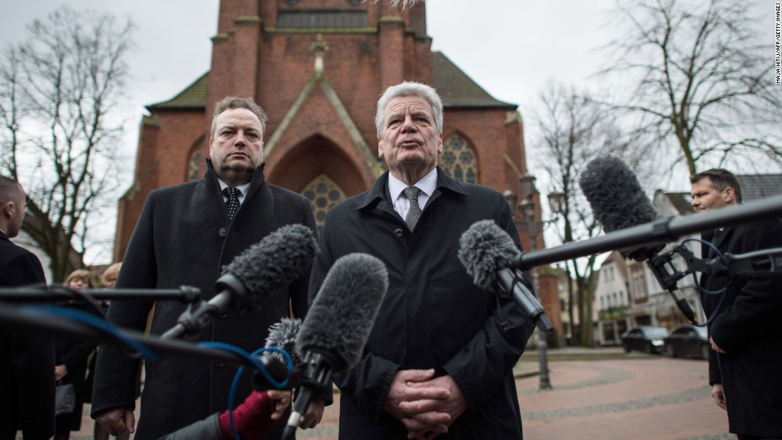 German President Joachim Gauck, alongside Haltern Mayor Bodo Klimpel, delivers a statement March 27 at a church in Haltern.