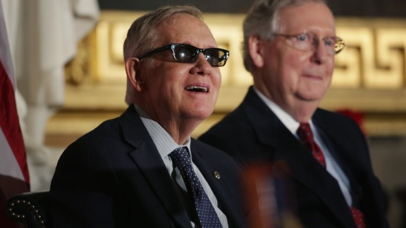 Reid and Senate Majority Leader Mitch McConnell, R-Kentucky, stand for the playing of the national anthem during Jack Nicklaus' Congressional Gold Medal ceremony in the U.S. Capitol Rotunda on March 24.