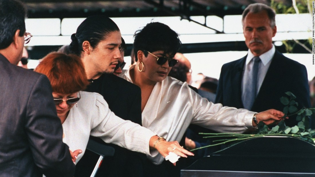 Selena's mother, Marcela Quintanilla; husband, Chris Perez; and sister, Suzette, lay roses on her casket at her funeral.
