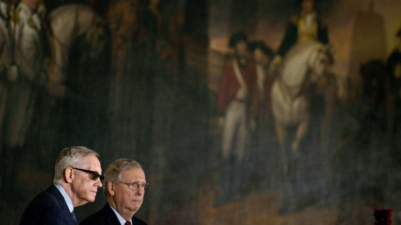 Reid and McConnell listen during a Congressional Gold Medal ceremony on Capitol Hill.