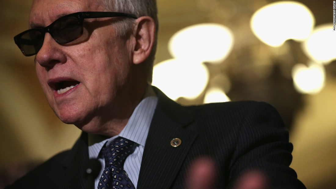 Reid speaks to members of the media after the weekly Democratic Policy Luncheon March 24 at the U.S. Capitol.