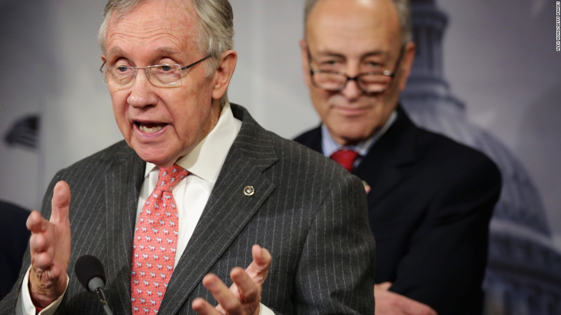 Reid speaks as Sen. Charles Schumer, D-New York,  listens during a news conference March 26, 2014. Reid endorsed Schumer to succeed him as minority leader.