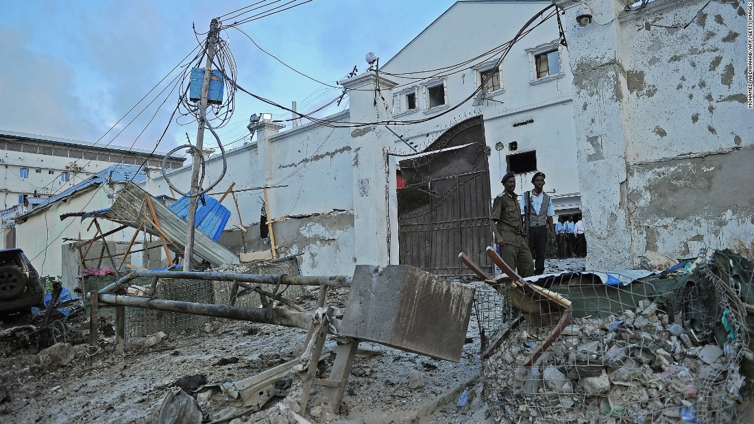 Security guards stand at the Makka Al Mukarama hotel, which was the site of a car bomb and gunbattle Friday, March 27, in Mogadishu, Somalia. Islamist militant group Al-Shabaab claimed responsibility for the deadly attack.