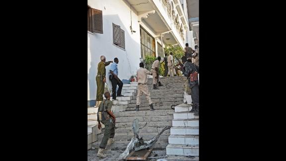 Security personnel stand guard at the hotel, which is popular with lawmakers, journalists and businesspeople.