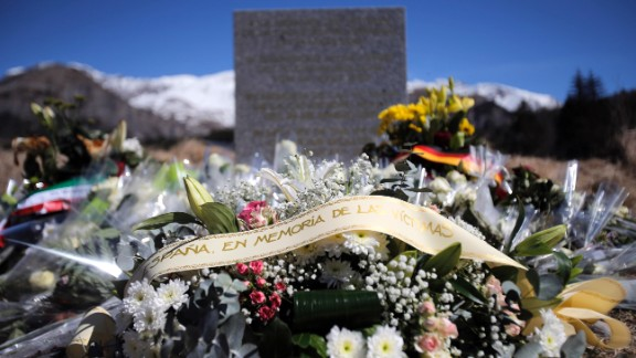 A stele and flowers laid in memory of the victims are placed in the area where the Germanwings jetliner crashed in the French Alps, in  Le Vernet, France, Friday, March 27, 2015. The crash of Germanwings Flight 9525 into an Alpine mountain, which killed all 150 people aboard, has raised questions about the mental state of the co-pilot. Authorities believe the 27-year-old German deliberately sought to destroy the Airbus A320 as it flew Tuesday from Barcelona to Duesseldorf. (AP Photo/Christophe Ena)
