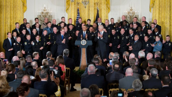 """President Barack Obama and Vice President Joe Biden with 2014 """"TOP COPS"""" at White House ceremony. May 12, 2014. (AP Photo)"""