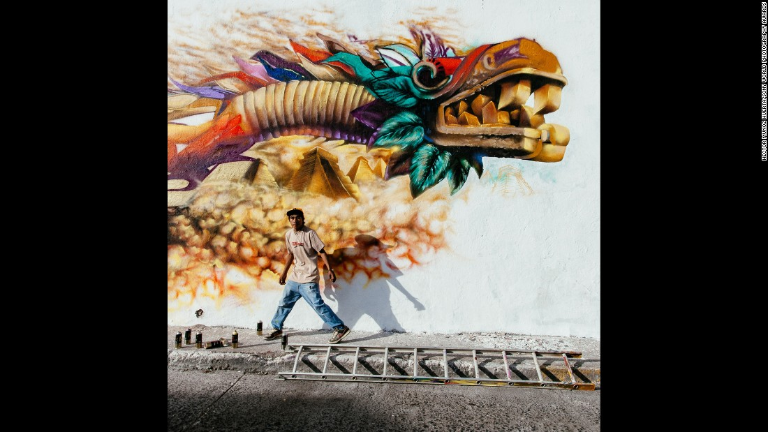 "<strong>""Quetzalcoatl"" by Hector Munoz Huerta</strong><br />Photographer's description: I have been snapping pictures of street performers for a couple of years. On January 31 last year I was heading downtown with my family as I found these graffiti artists working on a large mural, which I have spotted a few days before (in Queretaro, Mexico). I asked my wife to wait for five minutes and I started shooting. These boys are very talented and have been replacing ugly tag-patched walls with murals in the surroundings of the San Gregorio neighborhood for some years. This picture is my favorite image of 2014."
