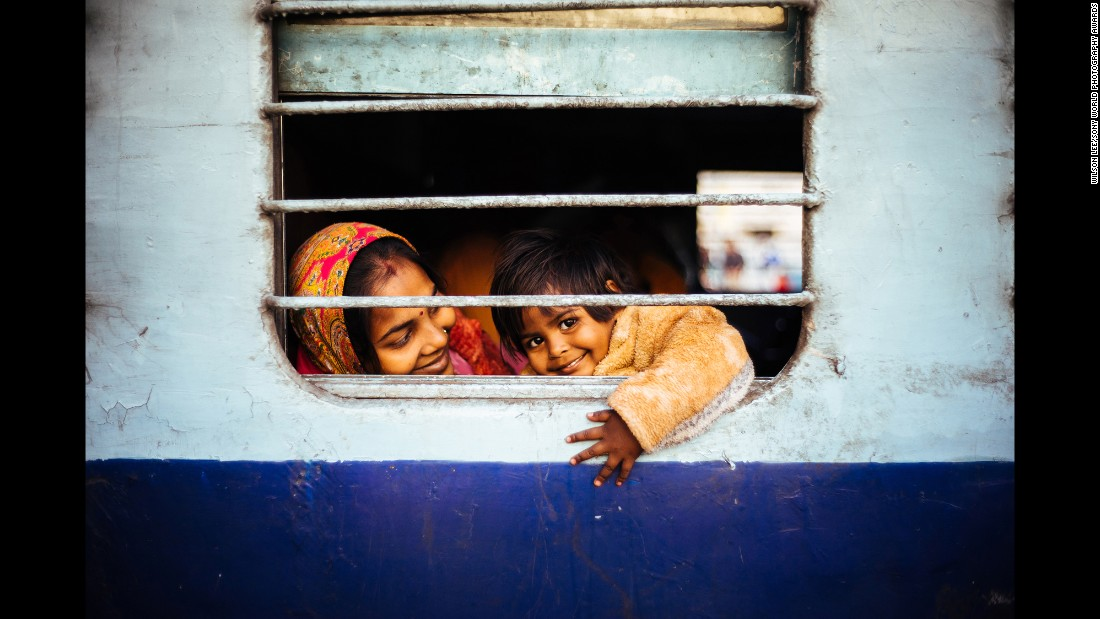 "<strong>""Happiness"" by Wilson Lee</strong><br />Photographer's description: Simplicity is happiness. I took this photo at a train station in Jaipur when I was traveling in India last year. Wandering around the platform, I attempted to capture the atmosphere before the train's departure."