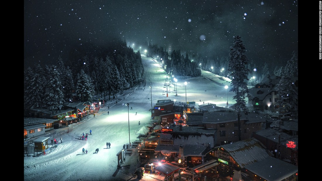 "<strong>""Winter dream"" by Yasen Georgiev</strong><br />Photographer's description: The image was taken in March of 2014. I was on a skiing holiday with friends in Borovets, which is one of the most famous ski resorts in Bulgaria. The last night before we left, I was looking out of my hotel room and dreaming of staying few more days. It was such a calm atmosphere, and I decided to take a final picture before I had to go. I wanted to catch the snow and bring atmosphere to the photo, so I turned the flash on. That's how I made this amazing landscape, which truly illustrates my winter dream."