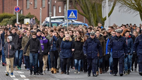 Students of the Joseph-Koenig Gymnasium school arrive for a memorial service in Haltern, Germany, on Friday, March 27. Sixteen students and two teachers from Haltern were among the victims.