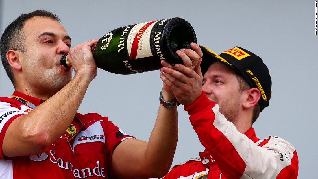 A champagne moment for Vettel and the Ferrari team after the surprise victory in Malaysia.