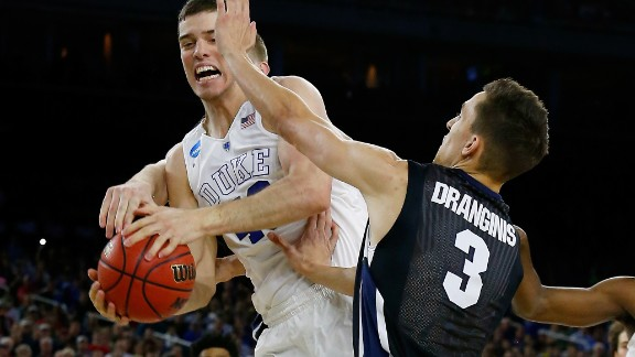 Marshall Plumlee (40) of the Duke Blue Devils and Kyle Dranginis (3) of the Gonzaga Bulldogs go for a rebound during the South Regional Final of the 2015 NCAA Men's Basketball Tournament at NRG Stadium on March 29, 2015 in Houston, Texas.