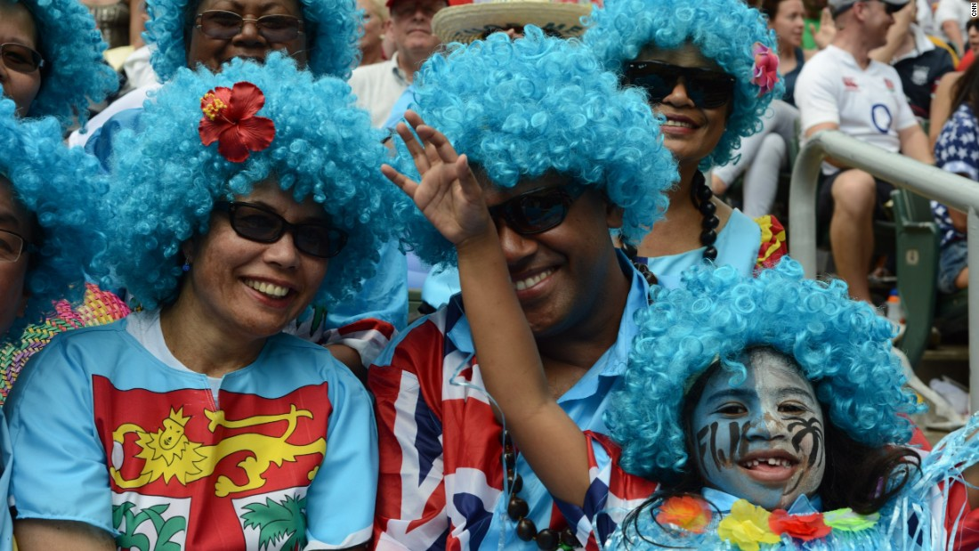 Fiji fans cheer on rugby players from the spectator stands.