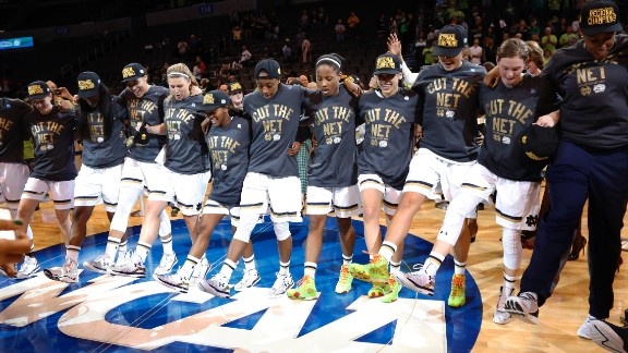 Notre Dame celebrates after defeating Baylor 77-68 in a regional final in the NCAA women's college basketball tournament, Sunday, March 29, 2015, in Oklahoma City. (AP Photo/Sue Ogrocki)