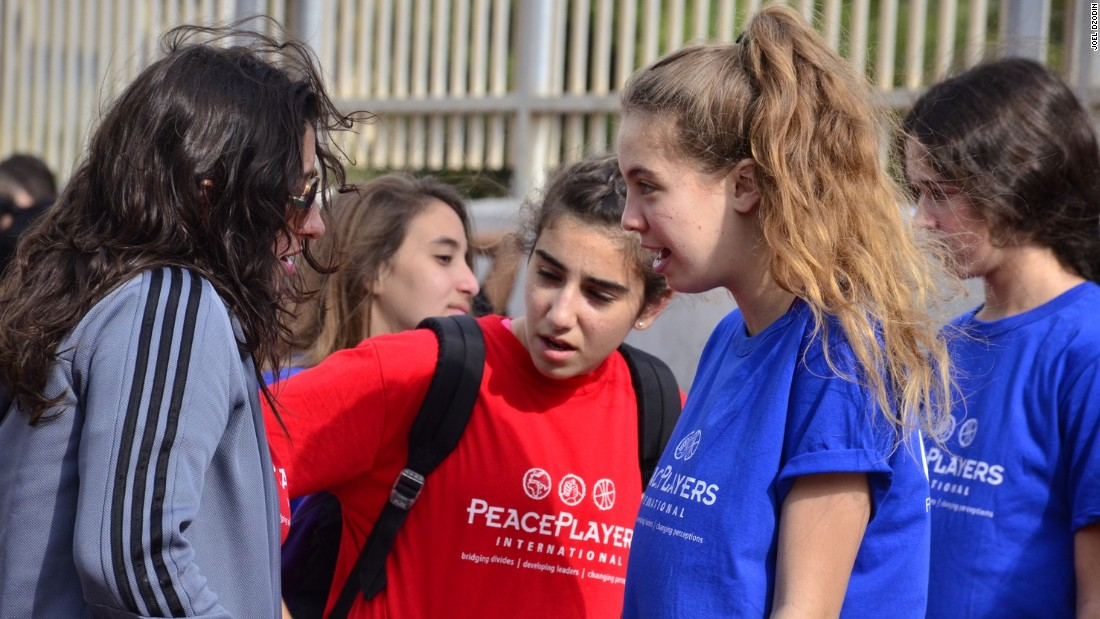 Toot (right) says her experiences at PeacePlayers have completely transformed her opinions of Palestinians.