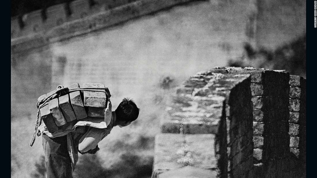 A man carries a load of stones on his back on the Great Wall in 1984. China restored the Great Wall at Badaling in 1984, making it more accessible. It's one of the most popular tourist sites in Beijing.