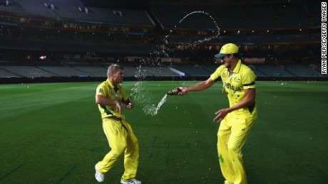 Australian cricketer Mitchell Starc douses teammate David Warner in beer in early morning celebrations at the Melbourne Cricket Ground after their World Cup victory.