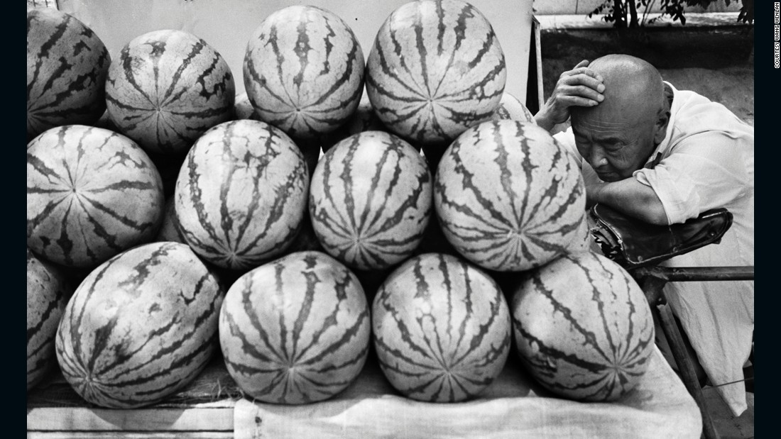 A watermelon vendor takes a nap in Beijing, 1995. Wang says he likes to capture life's more mundane moments.