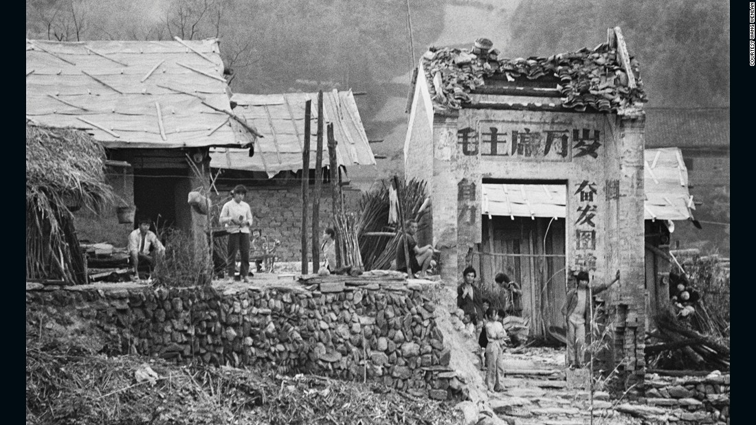"The village of Sanjiang, Guangxi photographed in 1988. The characters on the village gate read ""Long live Chairman Mao"" -- the most common political slogan during the Cultural Revolution."