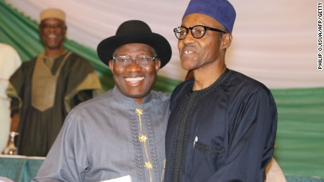 Caption:Nigerian President Goodluck Jonathan (L) and APC main opposition party's presidential candidate Mohammadu Buhari (R) smile after signing the renewal of the pledges for peaceful elections on March 26, 2015 in Abuja. Security is a major concern at Saturday's vote both from Boko Haram violence against voters and polling stations to clashes between rival supporters. In 2011, around 1,000 people were killed in violence after Jonathan beat Buhari to the presidency. AFP PHOTO / PHILIP OJISUA (Photo credit should read PHILIP OJISUA/AFP/Getty Images)