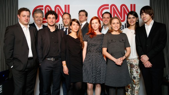 Award winners are photographed with CNN London Bureau Chief Tommy Evans, center, and Nina dos Santos, 3rd from right.