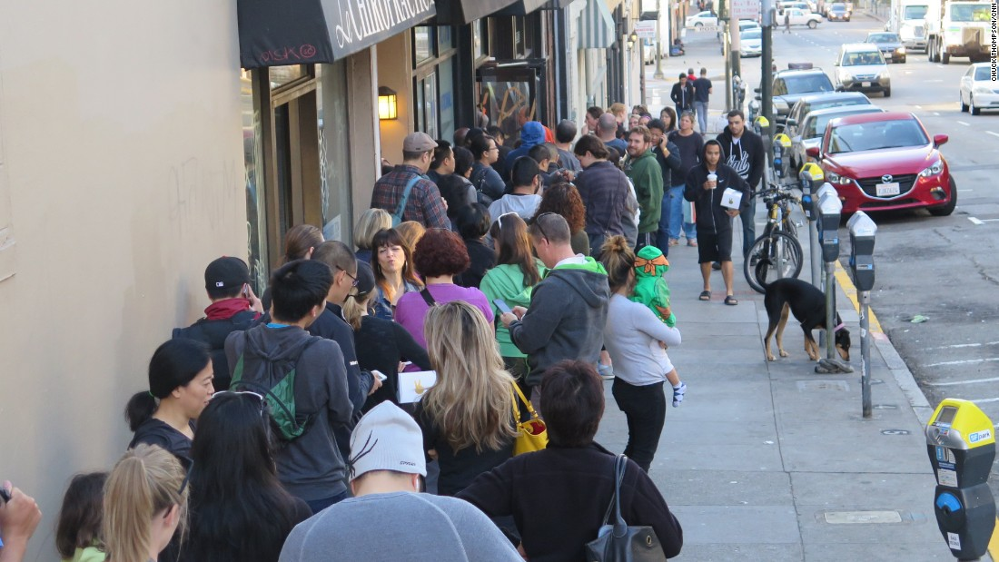Hungry fans line up for cruffins in San Francisco outside Mr. Holmes Bakehouse in the early morning.  Freshly baked cruffins come out at 9am every day and are usually sold out by noon.
