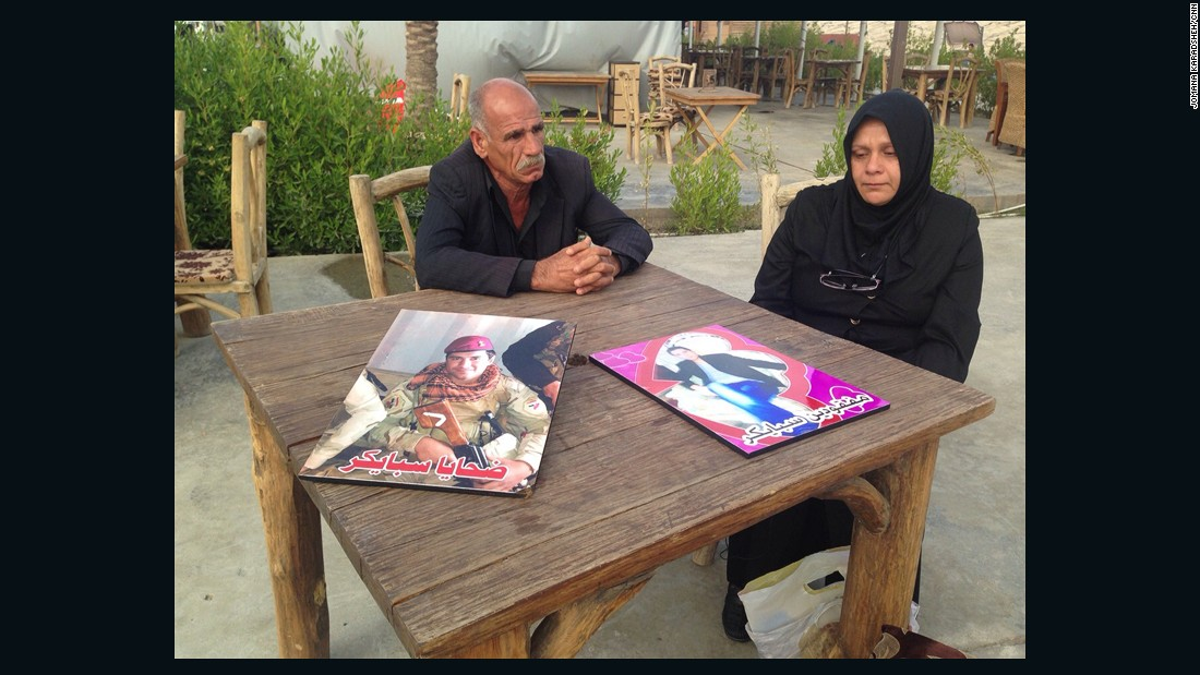 The parents of Imad al-Jubouri, one of the missing recruits, tell their story at a restaurant in Baghdad on March 29, 2015.