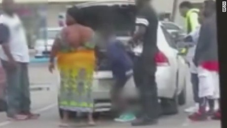 pkg video shows family piling into car trunk _00001129