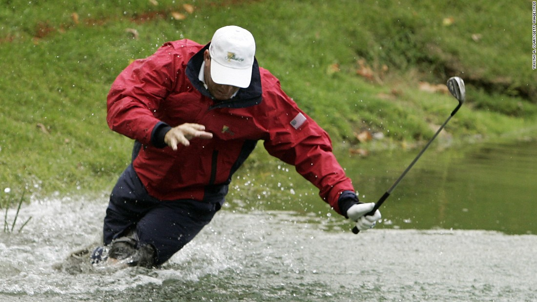 Golf-ball divers can make a thriving business from other people's misfortune. Here, U.S. player Woody Austin falls while hitting his ball out of the water at the four-ball matches of the 2007 Presidents Cup in Montreal, Canada.