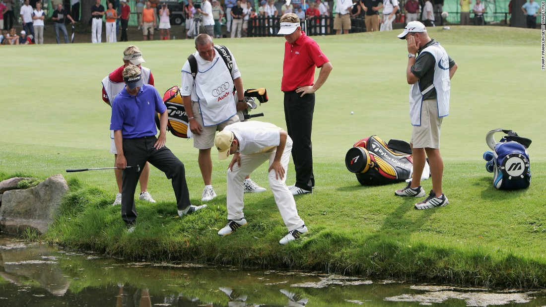 "Players hunt for a wayward golf ball during the 2006 Players Championship of Europe. The visibility isn't much better underwater. ""The balls are on the bottom, so as you start picking them up you're stirring up all the silt. If you could see before you started, you can't see while you're working,"" says diver Paul Lovelace."