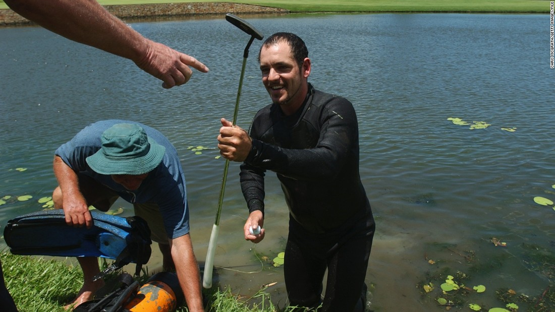 But golf balls aren't the only thing divers come across in the water. Here, a diver retrieves John Daly's putter and ball at the 2002 Australian PGA Championship in Queensland.