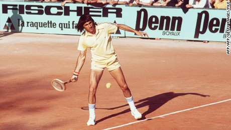Ilie Nastase returns a ball during the Paris International tournament in June 1977.